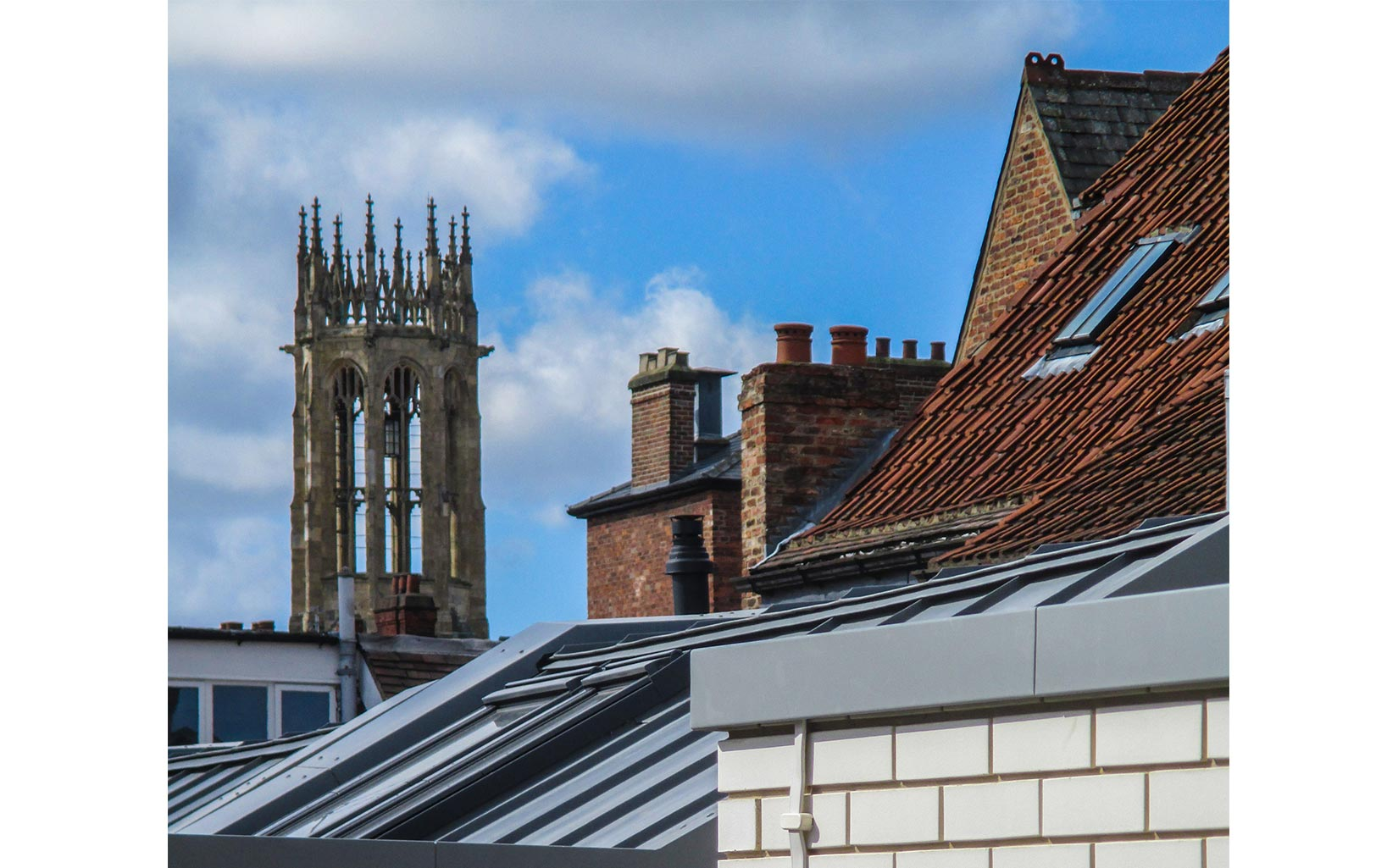 Scala Yard and The Electric Cinema, York, White brick with York Minster in the background