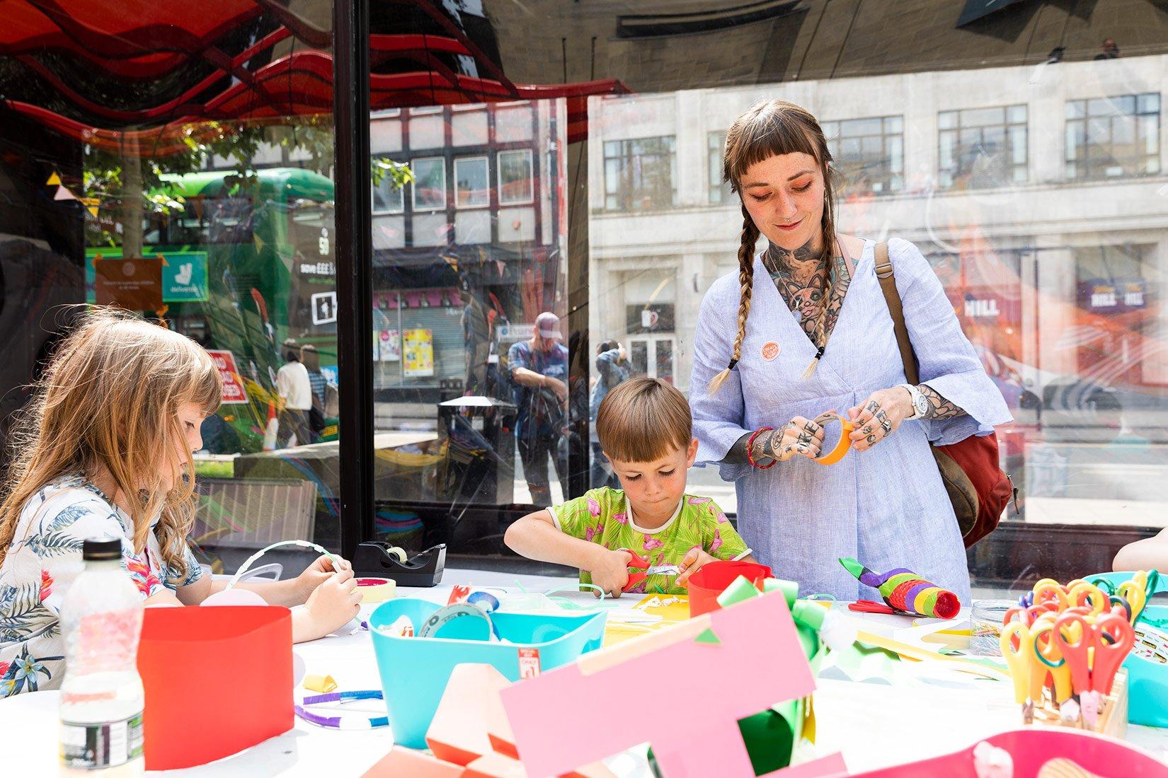 Create, Sculpt, Play 2019, outside Victoria Gardens, Leeds, woman, children activities